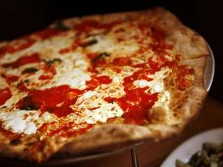 A margherita pizza is served at The Pie