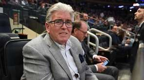 Mike Francesa, radio talk show host, watches an
