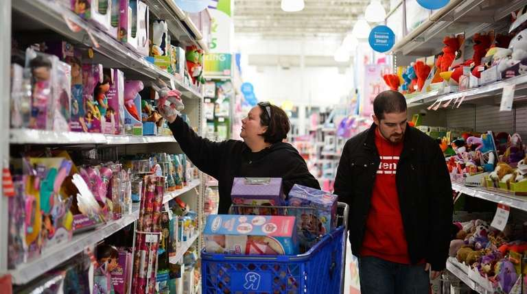 Shoppers browse the shelves at the Toys R