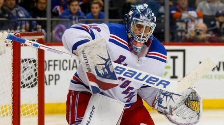 Henrik Lundqvist of the Rangers makes a save