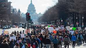 Thousands of local students march down Pennsylvania Avenue