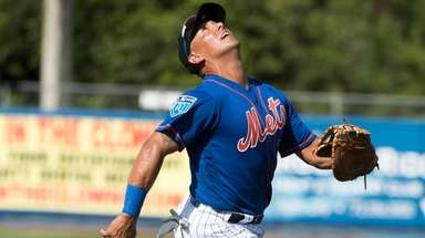 Mets infielder Phil Evans runs after a fly