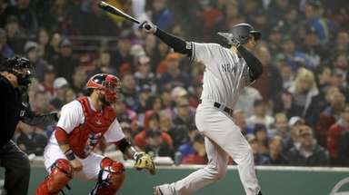 Yankees' Greg Bird watches an RBI single in