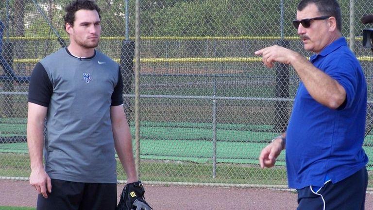 Keith Hernandez, right, instructing Daniel Murphy on the