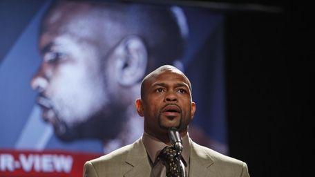 Boxer Roy Jones Jr. speaks to reporters during