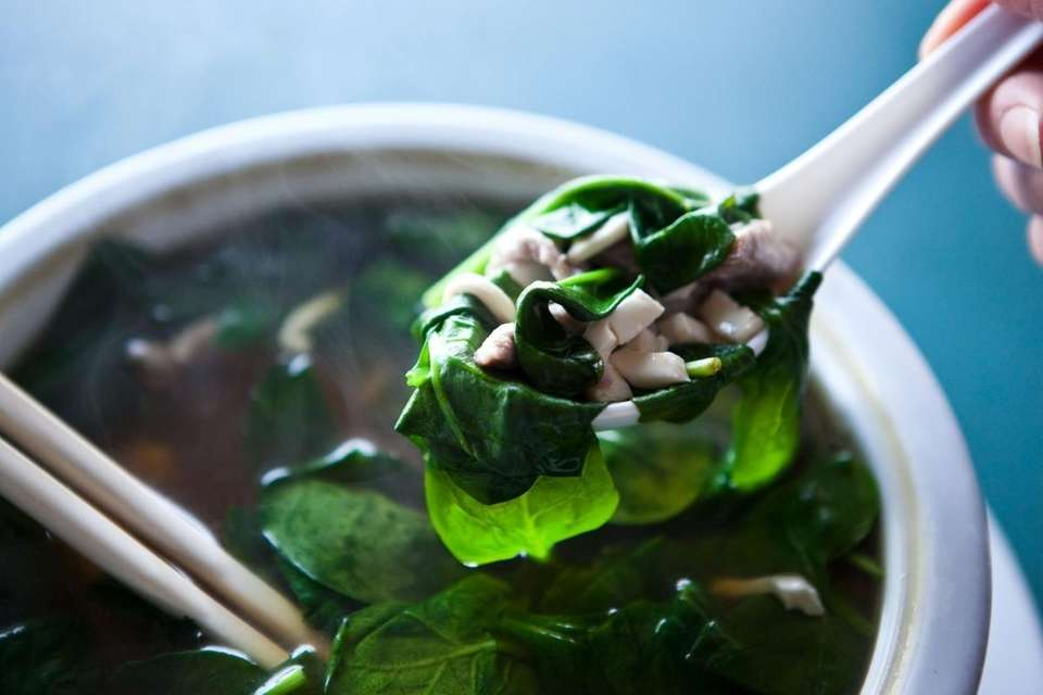 The broth of the soothing tofu-spinach-pork soup at