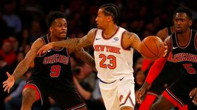 Trey Burke of the Knicks controls the ball