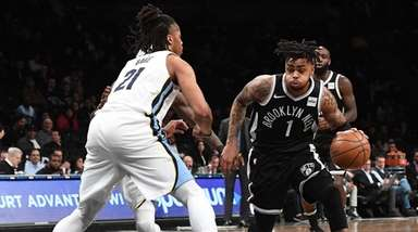Nets guard D'Angelo Russell drives the ball defended