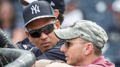 Former Yankees third baseman Alex Rodriguez speaks with