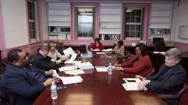 Members of the Hempstead board of education met