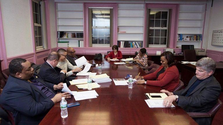 Members of the Hempstead board of education met