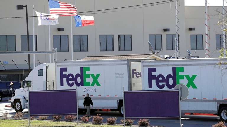 An FBI agent investigates at a FedEx distribution