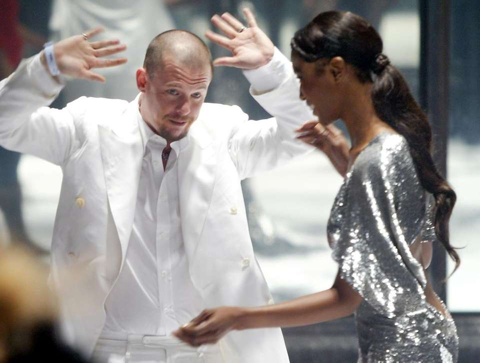 Designer Alexander McQueen greeted by model Naomi Campbell