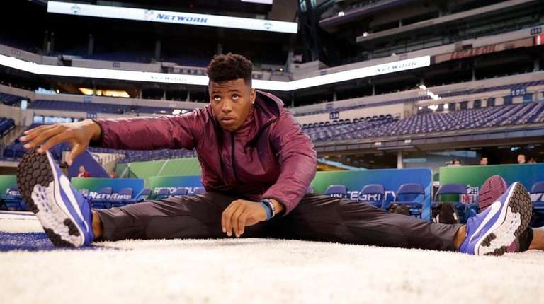 Penn State running back Saquon Barkley stretches at
