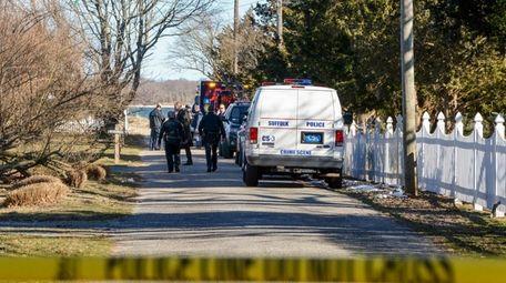 Police investigate the scene of a home invasion