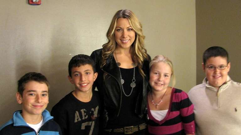 Singer Colbie Caillat with Kidsday reporters (from left)