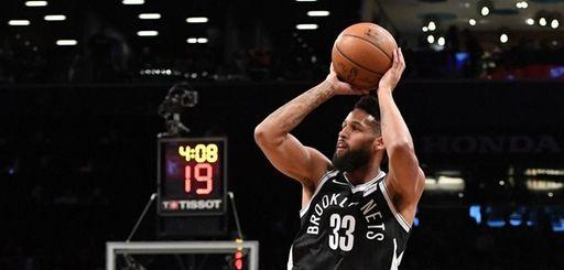 Brooklyn Nets guard Allen Crabbe shoots for three