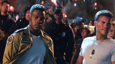 John Boyega as Jake Pentecost, left, and Scott