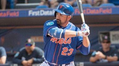 Mets first basemanAdrian Gonzalez bats during a spring