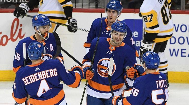 Islanders defenseman Adam Pelech, center, celebrates his goal
