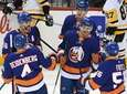 Islanders defenseman Adam Pelech, center, celebrates his goal