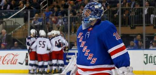Henrik Lundqvist of the Rangers reacts after surrendering