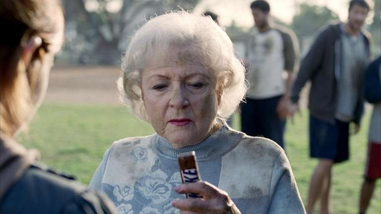 Betty White is featured in a Snickers candy