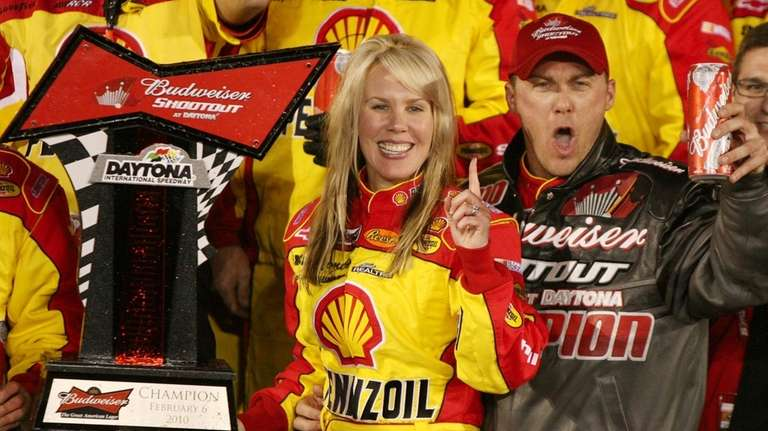 Kevin Harvick celebrates with his wife, DeLana, after