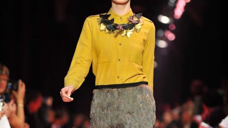 A model walks the runway during the Jason
