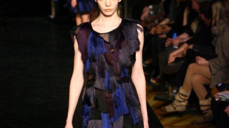 A model walks the runway at the Cynthia