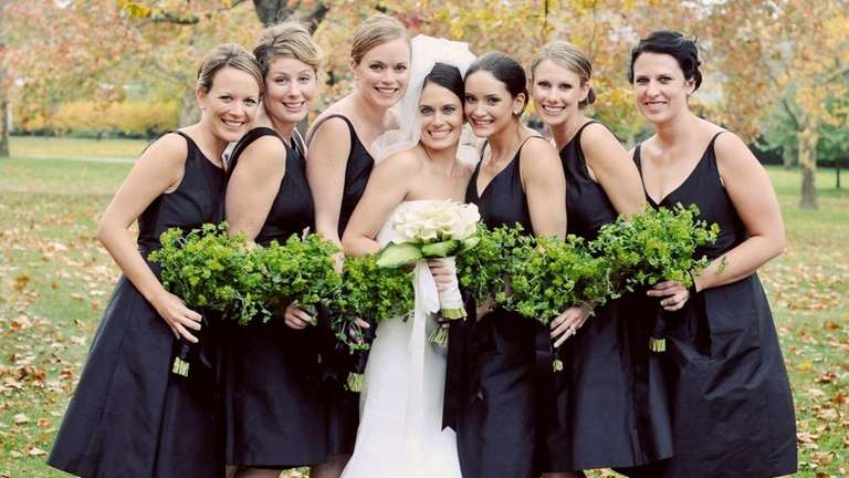 Bridesmaids poses with bouquets by floral designer Nancy
