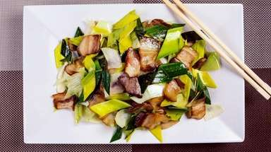 Hunan smoked pork with garlic stems is actually