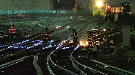 A Long Island Rail Road crew uses fire