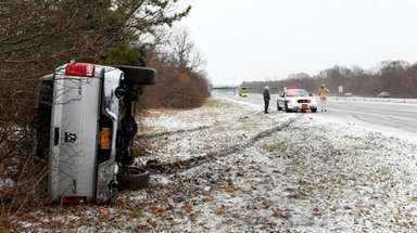 An overturned vehicle on the westbound Long Island