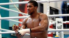 Britain's World Heavyweight Champion Anthony Joshua tapes his