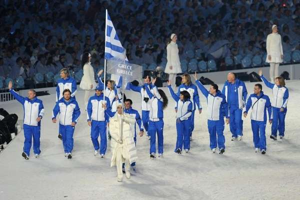 Greece's flag bearer, biathlete and cross-country skier Athanassios