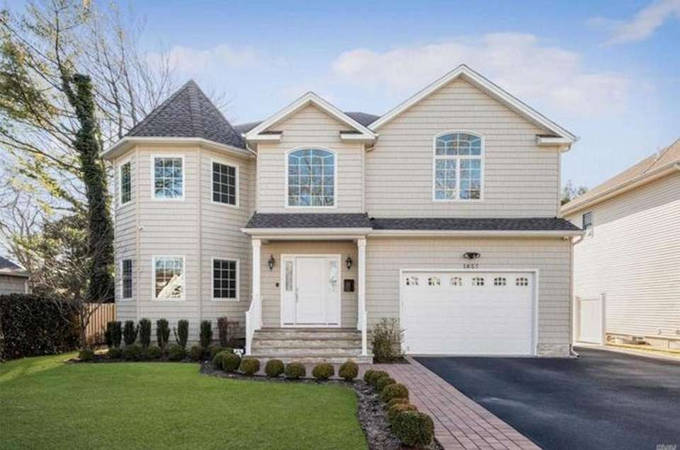 This Hewlett Colonial includes four bedrooms and 3