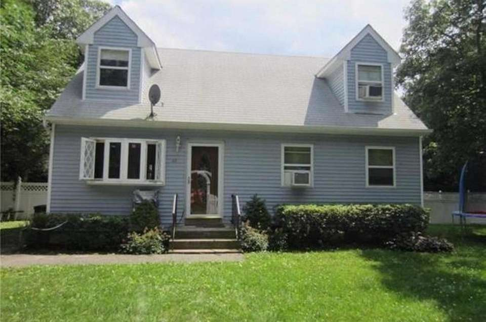 This Medford expanded-Cape includes four bedrooms and three
