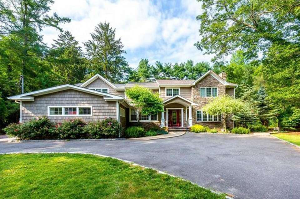 This Dix Hills Colonial includes five bedrooms and