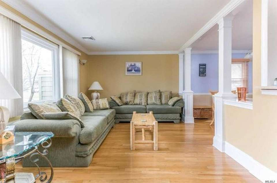 Hardwood floors are featured in the living room