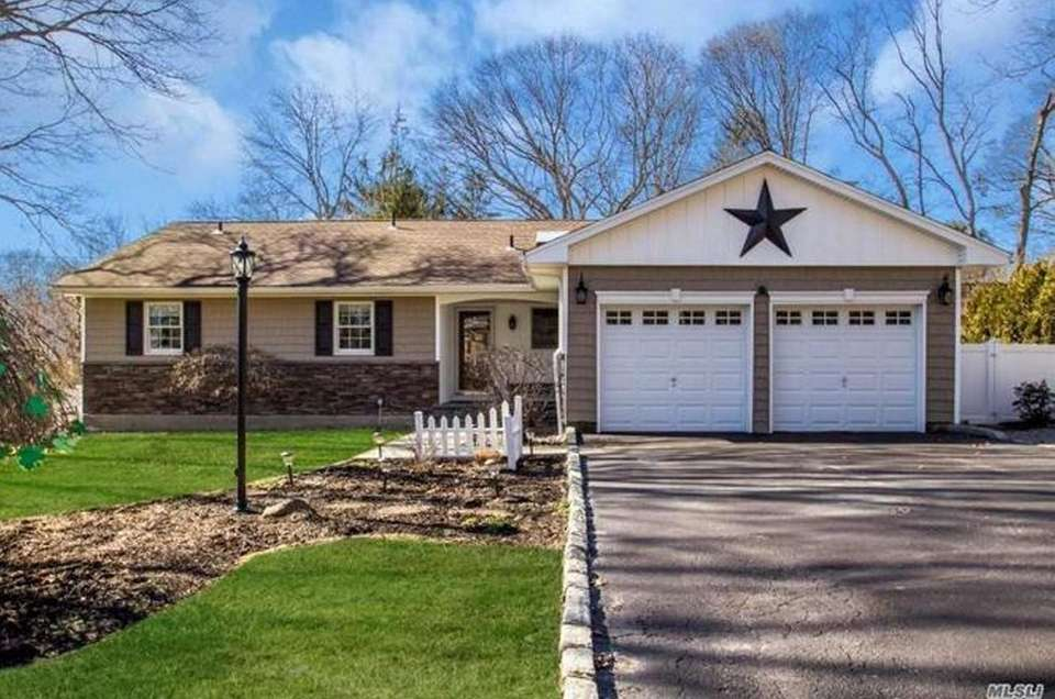 This Setauket ranch includes four bedrooms and 2