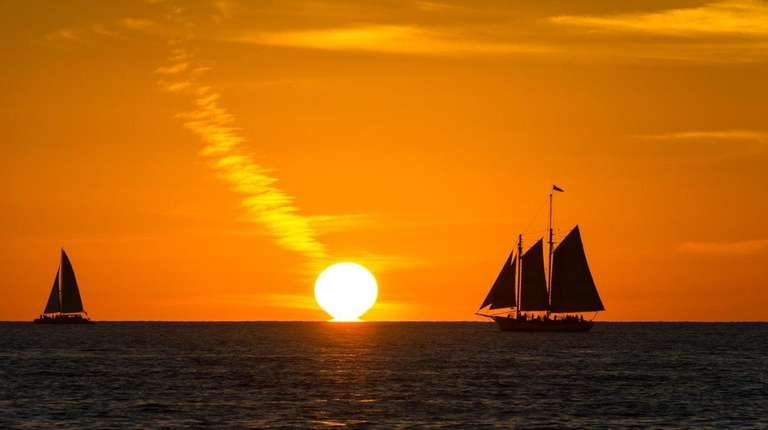 Sails in the sunset off Key West evoke