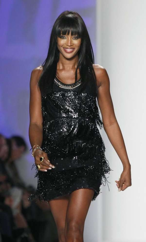 Naomi Campbell walks the runway during her Fashion