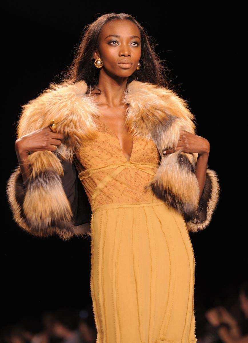 A models walks the runway at Naomi Campbell's