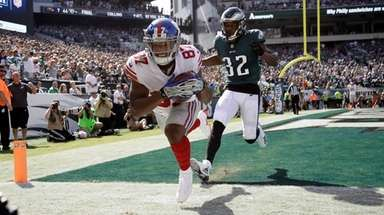 New York Giants' Sterling Shepard, left, against Philadelphia