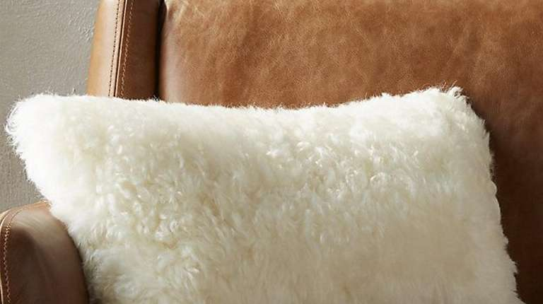 The CB2 Icelandic shorn sheepskin pillow.