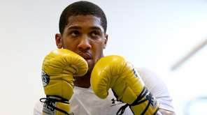 Anthony Joshua trains during a media workout at