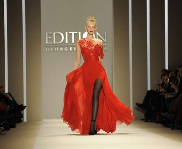 A model walks the runway at the Georges