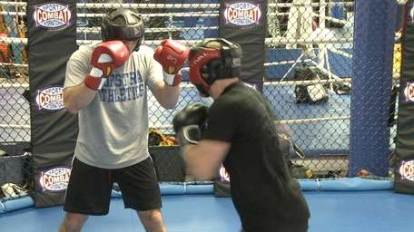 Gian Villante and Ryan LaFlare train together at