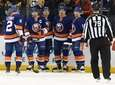 Islanders players celebrate a power-play goal by Anders